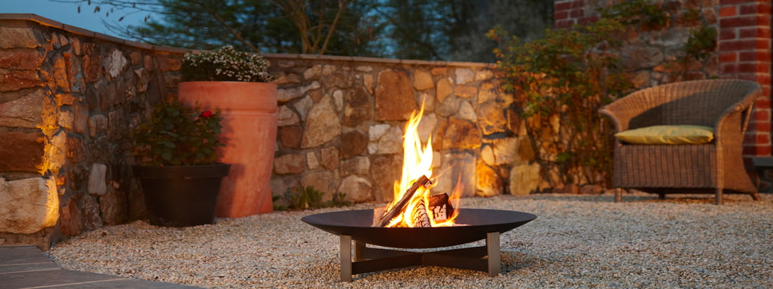 Buy the Sunset Fireplace from the german design brand artepuro. A bright fire in a black, high quality bowl - the eye-catcher in the evening. Designed by Katrin und Norbert Weber.