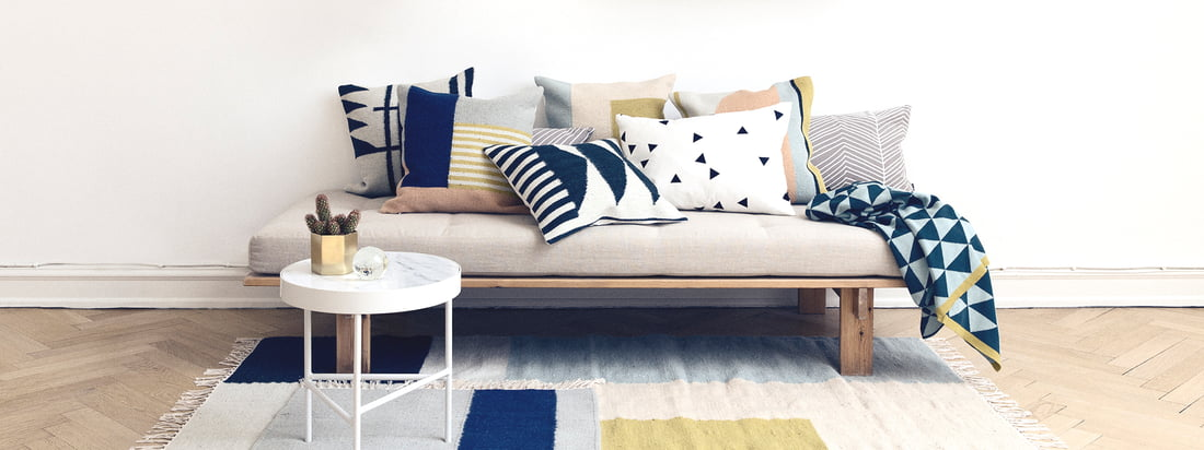 Herringbone cushion by ferm Living on the sofa - living room - carpet