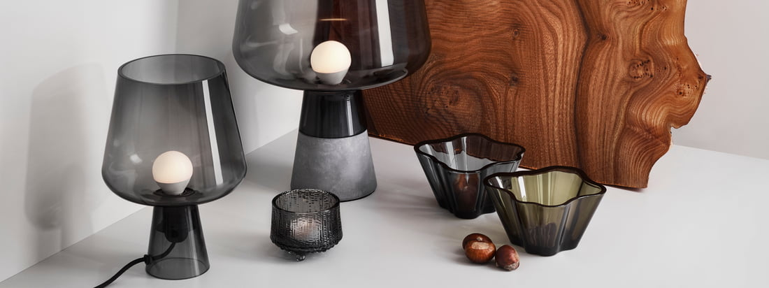 "Lifestyle product image of the Iittala - Leimu lamps, grey. Leimu, in German ""Flamme"", brings the eponymous, warm and cosy light into the living room. The unusual cup shape of the Iittala luminaire surprises even before the second exciting detail becomes visible."