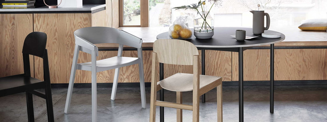 The Muuto Cover chair made of wood with a black table and gray chair for the Japandi trend.