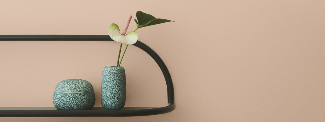 Gemma storage box with lid by AYTM in the ambience view. The storage box and the vase in the colour dusty green can be presented well on a wall shelf.