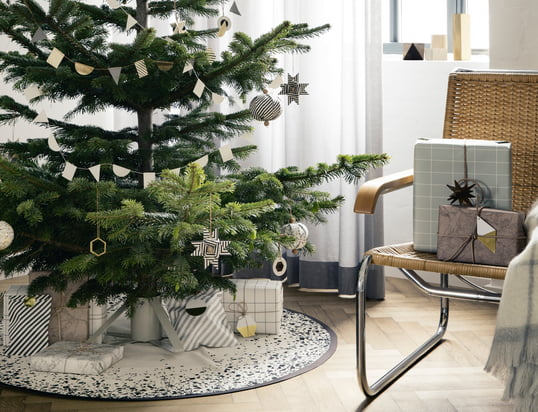 The Christmas spirit is here with the brass ornaments, Christmas tree stand and Christmas tree blanket from ferm Living