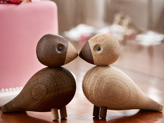 The lovebirds by Kay Bojesen are an hommage to the small African parrots, whose essential characteristic are their strong pair bonds. They are made from high-quality natural and smoked oak wood.