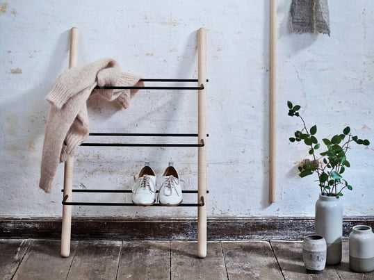The Stick shoe rack design of oiled/black ash wood by Norrmade is reduced to the most important elements and leaves room for shoes.