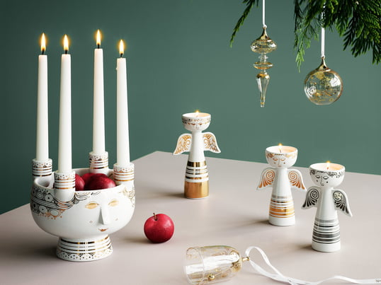 The Lucia candleholder by Bjørn Wiinblad out of ceramics is adorned with gold or silver details forming a face. Accommodating up to four candles and simultaneously acting as a bowl, the candleholder is a nice alternative to the classic Advent wreath.