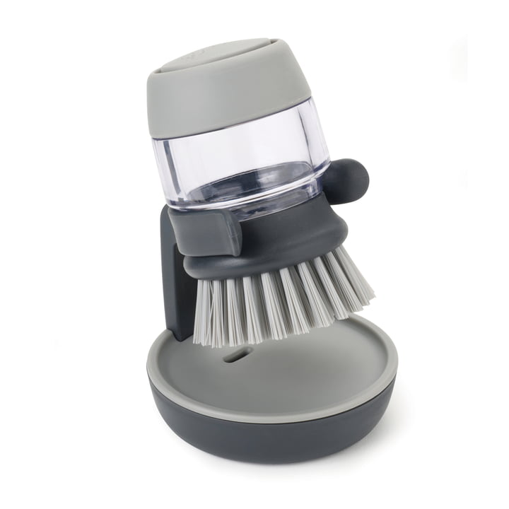 Palm Scrub Dishwashing brush with detergent dispenser from Joseph Joseph in grey