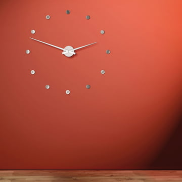 The Flexible wall clock on a red background