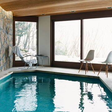 Vitra - Eames Plastic Side Chair DSW, by pool