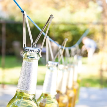 Stainless steel clamp to open bottles