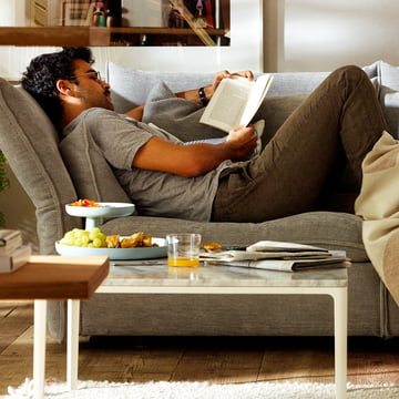 Relax with the Mariposa sofa in ice blue and the Rotary tray by Vitra
