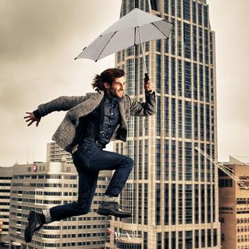 Senz - collection 2014, jumping man with umbrella