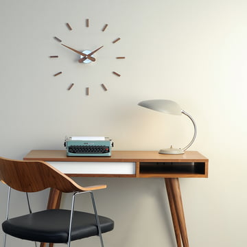 Sunset wall clock by nomon with 12 hour markers made of walnut wood