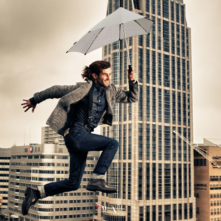 Senz - collection 2014, jumping man with umbrella