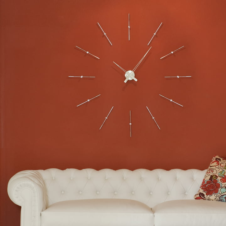 Merlin wall clock by nomon with 12 hour pointers in chrome and steel