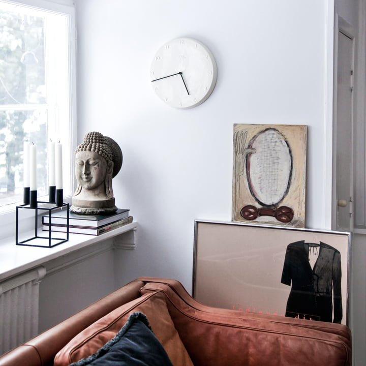 Ceramic wall clock with black hands