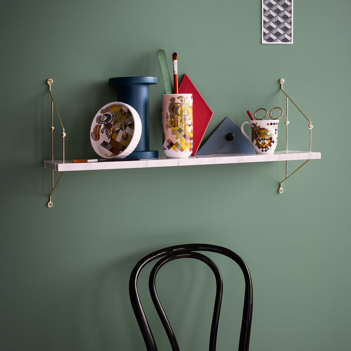 Bowls, Mugs and Cases from the Tapestry Series by Bjørn Wiinblad on a Shelf