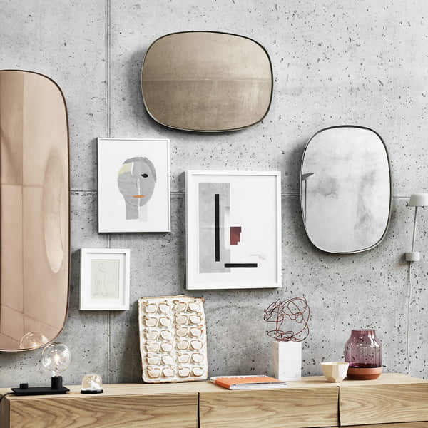 Framed mirrors on the living room wall